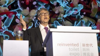 Bill Gates brandishes poo to showcase reinvented toilet tech