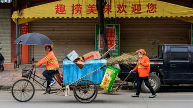 Chinese officials force street cleaners to wear GPS-tracking bracelets